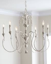 spindly asymmetrical chandelier with leaf and vine motif handcrafted of steel and polyresin hand painted distressed persian white finish amelie distressed chandelier perfect lighting