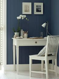 restful denim blue walls with fresh white painted floor and furniture for a similar blue paint shade try selwyn from the dulux colours of new zealand blue and white furniture