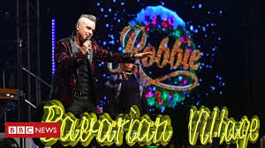 Robbie Williams hits number one and equals <b>Elvis Presley's</b> UK ...