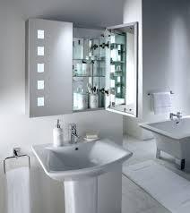 mirror above rectangular basin in modern city bathroom with toilet beside bath with glass shower screen brilliant bathroom mirror lights