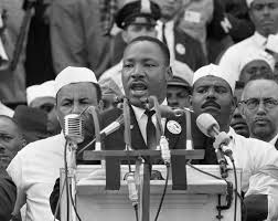 the life and legacy of martin luther king jr shareamerica martin luther king speaking into row of microphones crowd behind him © ap images