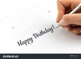 hand writing happy birthday on white stock photo  hand writing happy birthday on white sheet of paper