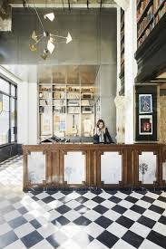 above the ace hotel in downtown laone of several ace hotels designed by communeis filled with surprise elements by artists the reception desk is the california interiors commune designs