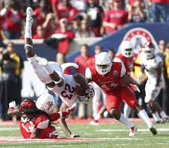 hard work pays off for uh in conference title houston chronicle houston safety trevon stewart left upends temple receiver romond deloatch during the fourth quarter