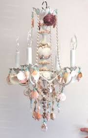 crystal and shell chandelier embellished witih seashells beach cottage style home decor lighting beach theme lighting
