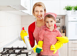 clean kitchen: mother and daughter in the kitchen