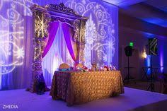 loving this setup with a gobo monogram at this beautiful uplighting wedding beautiful color table uplighting