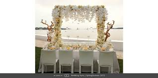 day orchid decor: bell mer newport wedding tabletop white orchid arbor seashell photo