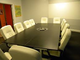 modern office conference room with rectangular white wooden meeting table and dark gray arm chairs chic office ideas furniture dazzling executive office
