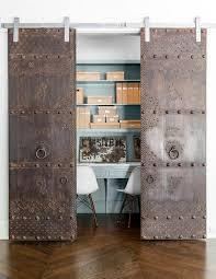 rustic and antique sliding doors add uniqueness to the small home office from robert add home office