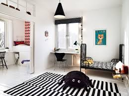 m charming scandinavian kids bedroom with black polished iron bed frame and white finish wooden floating desk be equipped black plastic chair using charming kids desk