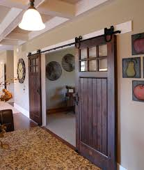 sliding barn doors these doors look fabulous in this contemporary style home the dark barn style sliding doors