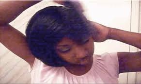 It was her hair, secured in what is known as a doobie wrap, a roller wrap, or just a wrap, depending on where you're from. - anigif_enhanced-buzz-32147-1385357381-13