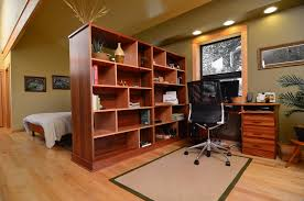 eco hideaway trendy home office photo in other with green walls medium tone hardwood floors and angled metal legs 4quotw