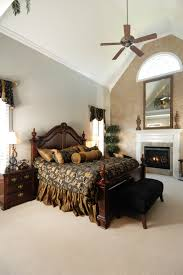big master bedrooms couch bedroom fireplace: the soaring cathedral ceilings keep the dark furniture and dark bedding from making the room feel
