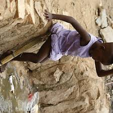 mapjd picture essay uganda slums   images   darrin zammit lupi    a child steps into an open sewer in kisenyi  a slum in kampala  march