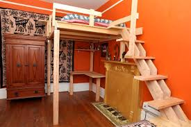 orange painted style bedroom for kids near cool kids loft bed accessed near unique wooden stairs awesome modern kids desks 2 unique kids