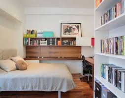 guest bedroom and home office with ample shelf space design raad studio bedroom guest office combination