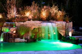 swimming pool with waterfall beautiful lighting pool
