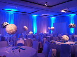 spectacular setup at this blue uplighting wedding reception diy blue wedding uplighting
