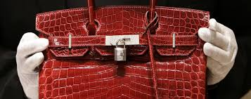 5 best sites for hunting down vintage hermès bags and luxury an employee holding a 129 000 us crocodile skin hermes birkin bag during
