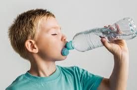 <b>Cute</b> kid drinking <b>water</b> from a <b>plastic bottle</b> Photo | Free Download