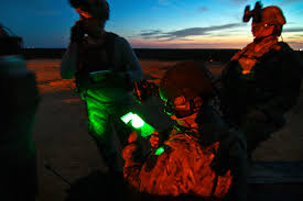 u s department of defense photo essay airmen review a medical evacuation checklist during a night training mission on fort dix n j