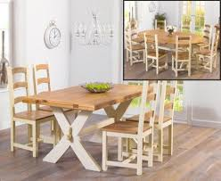 cream compact extending dining table: bordeaux solid oak and cream all sides extending dining table and marlow chairs
