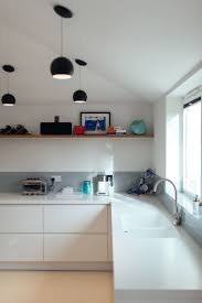 corian kitchen top: corian worktop grey splashback wooden shelf
