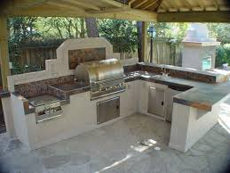 kitchen design entertaining includes: creating an outdoor cooking and entertaining space doesnt require a lot of space or money thats good news if youre looking for outdoor kitchen ideas on