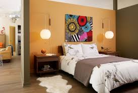artistic wall art painting decor between round bedroom pendant lights above wooden bed side table design artistic bedroom lighting ideas