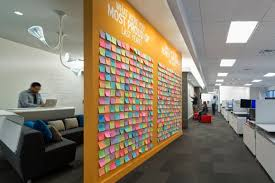 outsells post it note wall of achievements photo by jasper sanidad advertising agency office design