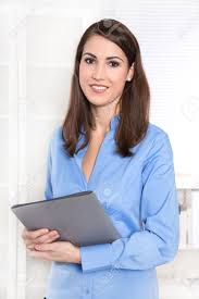 career portrait of a smiling young businessw in a blue blouse career portrait of a smiling young businessw in a blue blouse is going to a