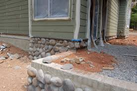 lots of river rock was added to the foundation this week foundation of the garage office near the breezeway which was also filled in with dirt and then breezeway garage office
