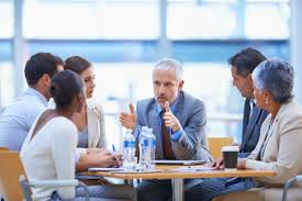 top mba programs best business schools resources us news us news a cropped shot of a businessman sharing an idea colleagues at a meeting middot top business schools