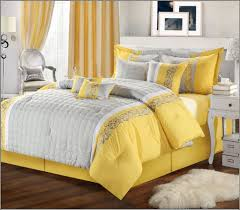 yellow and gray bedroom: graceful bedroom design using yellow curtain and gray arm chair