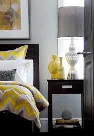 yellow and gray bedroom:  bedding and vases add pops of yellow to the gray bedroom design atmosphere interior