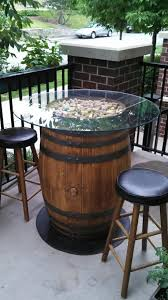 not quite a spool but a nice use of wine corks glass to top this barrel patio table more more arched table top wine cellar furniture