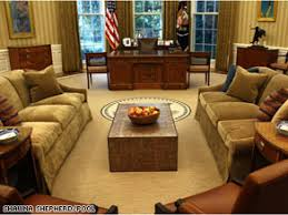 the makeover of the oval office has been widely panned in press reports and on the bill clinton oval office rug
