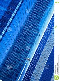 modern office architecture at blue glass exterior wall backgroun blue glass top modern office