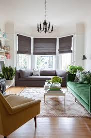 green living room design furniture dont love this room overall but note how they used the storage shelves
