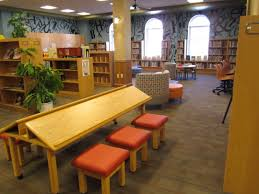 by reusing and reupholstering some of the libraries existing furniture and adding a couple of signature children library furniture