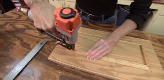kitchen cabinet door trim: attaching mitered molding to stained plywood cabinet doors