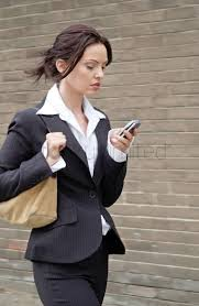 busy business w text messaging while walking to work stock busy business w text messaging while walking to work stock photo