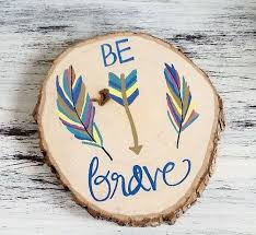 items similar to be brave wood slice painting aztec room decor feathers be brave room decor children nursery room decor wall hanging rustic on etsy brave professional office decorating ideas