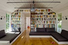 amazing home library decorating ideas featuring white wooden wall design and white wooden bookcase tower plus awesome home library design