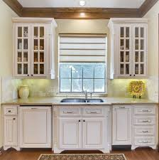 kitchen cabinets home office transitional: sensor trash can kitchen traditional with crown molding stone countertop tile tiled backspalsh white kitchen cabinets