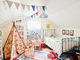 neutral attic kid bedroom design with amazing decoration and black polished metal bed frame which has amazing kids bedroom ideas calm