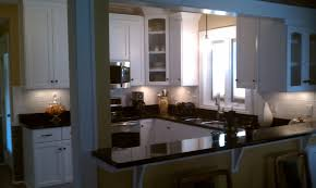 small u shaped kitchen design:  u shaped wooden kitchen middot black granite countertop on island also on white cabinetry also bar table also stools also panel
