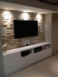 basement stone entertainment center with ikea cupboards wwwshannacreatio basement lighting ideas